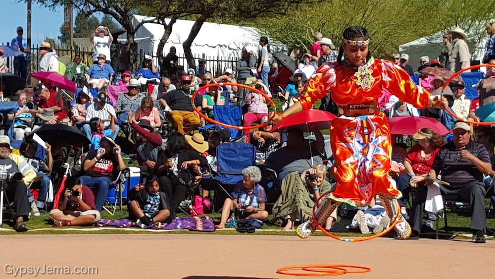 Woman native hoop dancing in Phoenix, Arizona