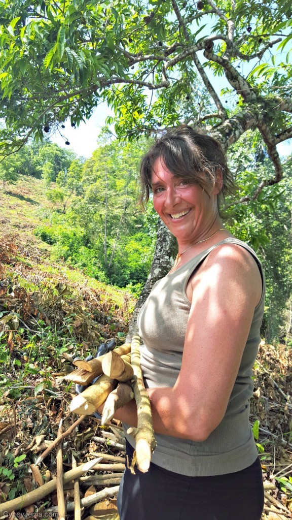 Andrea holding handmade stakes used to mark the trees we planted with IDDI