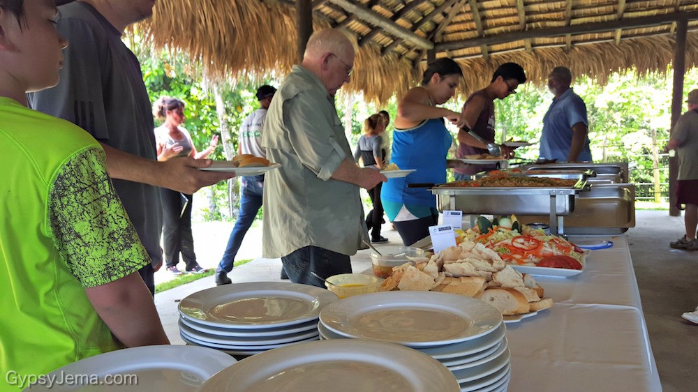 Buffet line with Fathom travelers after reforestation impact activity