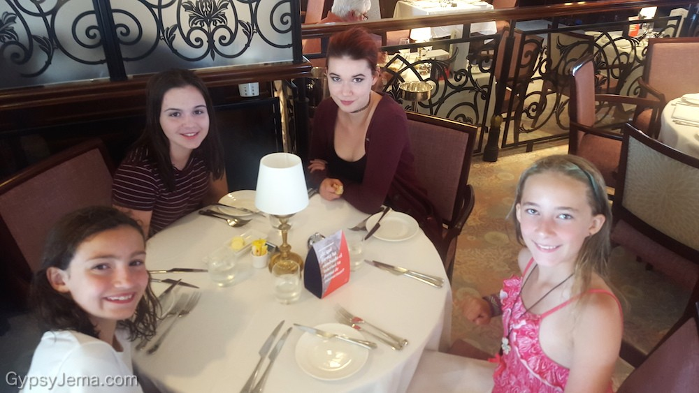 Kids out for dinner at the Pacific Restaurant while onboard Fathom Travel's Adonia cruise ship to the Domincan Republic