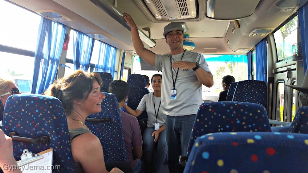 Our IDDI guide on the bus explaining how our volunteer work helps the community of the Domincan Republic