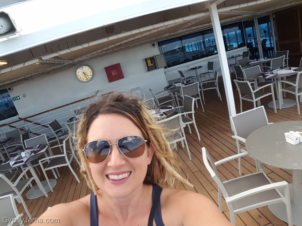 Soaking in the sun on the Conservatory Buffet deck on the Adonia cruise ship