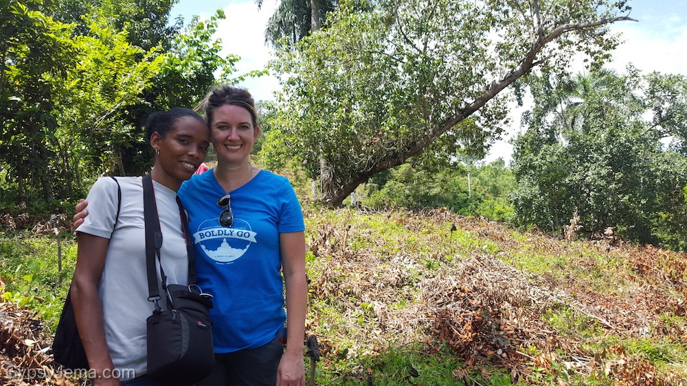 Standing with a photographer for IDDI as we plant trees in the Dominican Republic rain forest