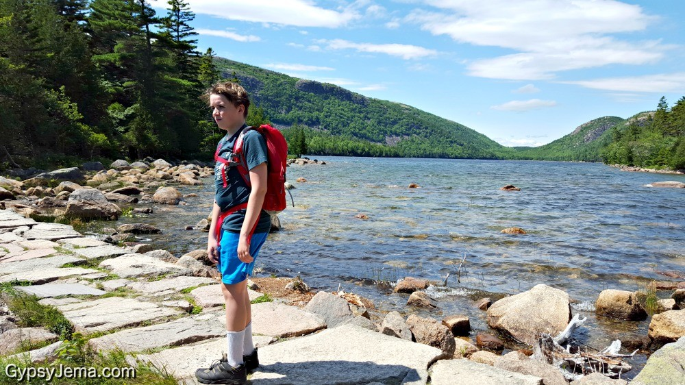 Hiking teen at Jordan Pond in Acadia National Park