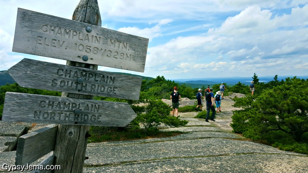 Teens hiking to the peak of Champlain Mountain in Maine.