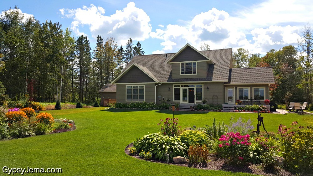 Minnesota lake home with flower gardens.